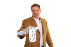 Happy Father's Day. Man holding a present with a tag saying Happy Father's Day in a brown suit coat isolated on white Stock Image