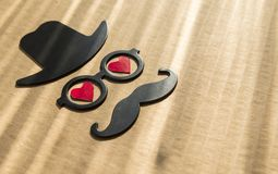 Happy Father`s day background or card. sign of black hat,. Mustache and pipe with two red heart - eyes with glasses. empty copy space for inscription. close-up Stock Photos