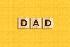 Happy father`s day background. Dad, Word, written on wooden blocks. Yellow background Congratulatory background. Happy father`s day background.Dad, Word, written vector illustration