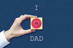 Happy father`s day background. Female hand with social heart icon. Dark background. Congratulatory background. Festive background stock photo