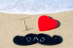 Happy father's day background. Sign I love dad on the sandy beach - Happy father's day background Stock Photography