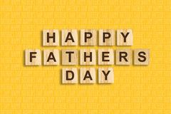 Happy father`s day background. Word, written on wooden blocks. Yellow background Congratulatory background. Festive background royalty free illustration