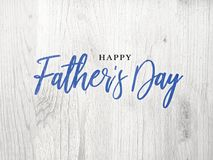 Happy Father`s Day Blue Calligraphy Script Over White Wood. Texture Background Stock Images