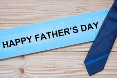 Happy Father`s Day with blue neckties on wooden background.  International Men`s Day concepts.  stock photos