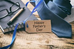 Happy Father`s day. Blue tie and tag, office desk background, copy space stock images