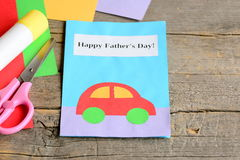 Happy Father`s day card. Colored paper sheets, scissors, glue on vintage wooden background. Father`s day gift. Card making crafts. Ideas for arts and crafts Royalty Free Stock Image