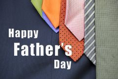 Happy Father`s day card concept. Message on colorful necktie design on blue suit background royalty free stock photography