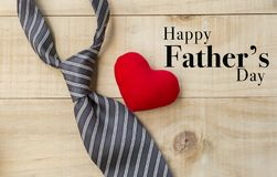 Happy father`s day card concept. Necktie with red heart on wooden background, love dad royalty free stock images