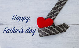 Happy Father`s day card concept. Necktie with red heart on white wood background Royalty Free Stock Photography