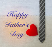 Happy Father`s day card concept. Red heart with black necktie design on canvas background Royalty Free Stock Photo