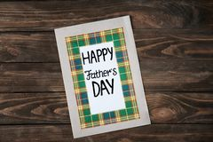 Happy Father`s Day card. On wooden table Royalty Free Stock Images