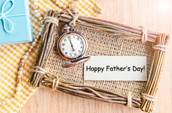 Happy father's day card. Happy father's day card paper with pocket watch and gift box on table Stock Photos