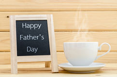 Happy father's day in chalkboard with a cup of coffee. Stock Image