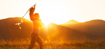 Happy father`s day! Child girl and dad with a kite on nature in Stock Photo