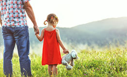 Happy father`s day! child girl with dad on nature Royalty Free Stock Photo