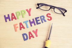 Happy Father's Day - colorful wording with glasses and screwdriv Royalty Free Stock Image