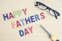 Happy Father's Day - colorful wording with glasses and screwdriv Royalty Free Stock Images