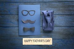 Happy Father`s Day concept. Card and tie in gift box. On wooden table Royalty Free Stock Photos