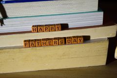 Happy father`s day concept with celebrate words written on wooden blocks royalty free stock photo