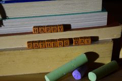 Happy father`s day concept with celebrate words written on wooden blocks stock photo