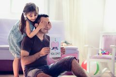 Happy Father`s Day Concept. Child Daughter Hiding Surprise Postc royalty free stock image