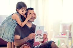 Happy Father`s Day Concept. Child Daughter Hiding Surprise Postc stock photos