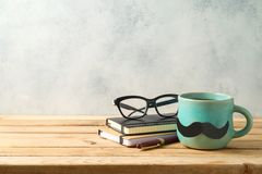 Happy Father`s day concept with coffee mug and business objects. Over wooden background royalty free stock photography