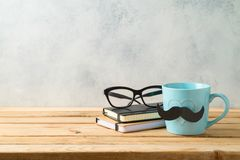 Happy Father`s day concept with coffee mug and business objects. Over wooden background stock photography