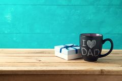 Happy Father`s day concept with coffee mug and gift box. Over wooden background stock photos