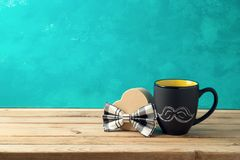 Happy Father`s day concept with coffee mug and gift box. Over wooden background royalty free stock photos