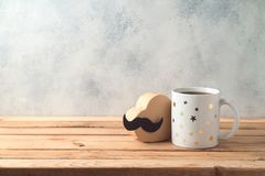 Happy Father`s day concept with coffee mug and gift box. Over wooden background royalty free stock image