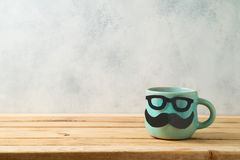 Happy Father`s day concept with cute funny coffee mug. Over wooden background stock photos