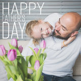 Happy father`s day concept, father and daughter having fun and smiling. Happy father`s day concept, father and daughter sitting on a couch having fun and smiling Royalty Free Stock Images