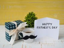 Happy father`s day concept. gift box, a cup of coffee with musta stock photo