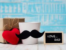 Happy father`s day concept. Gift box, a cup of coffee with must royalty free stock photo