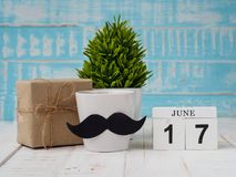 Happy father`s day concept. 17 June wooden block calendar, gift stock image