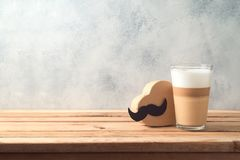 Happy Father`s day concept with latte macchiato coffee and gift box. Over wooden background royalty free stock image