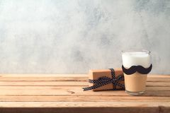 Happy Father`s day concept with latte macchiato coffee and gift box. Over wooden background royalty free stock images