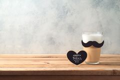 Happy Father`s day concept with latte macchiato coffee and mustache. Over wooden background royalty free stock photos