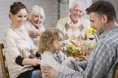 Happy father's day daddy!. Happy family during dinner celebrating father's day, smiling Royalty Free Stock Images