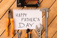 Happy father`s day . Different tools on wooden background royalty free stock photo