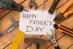 Happy father`s day . Different tools on wooden background royalty free stock photos
