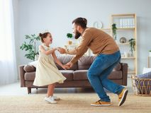 Happy father`s day! family dad and child daughter Princess dancing royalty free stock image
