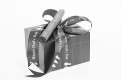 Happy Father's Day with a gift box and cuban cigar in black and white Stock Photo