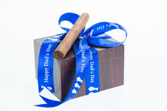Happy Father's Day with a gift box and cuban cigar Stock Images