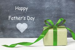 Happy father`s day. Gift box for dad. Greeting card for father. Message for daddy. Holiday concept Royalty Free Stock Photos