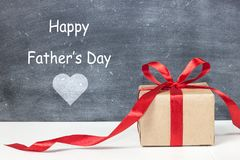 Happy father`s day. Gift box for dad. Greeting card for father. Message for daddy. Holiday concept Stock Image