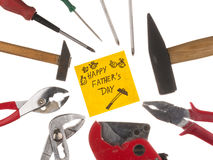 Happy father's day. Greeting card with the inscription - a Happy Father's Day, with the old work tools on a white background isolation Stock Image