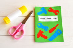Happy father's day. Greeting card with paper tools. Scissors, glue. Kids paper craft idea. Father's day gift idea Stock Photo