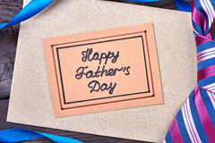 Happy Father`s Day greeting card. Ribbon and tie on wood. From kids to dad Royalty Free Stock Photos